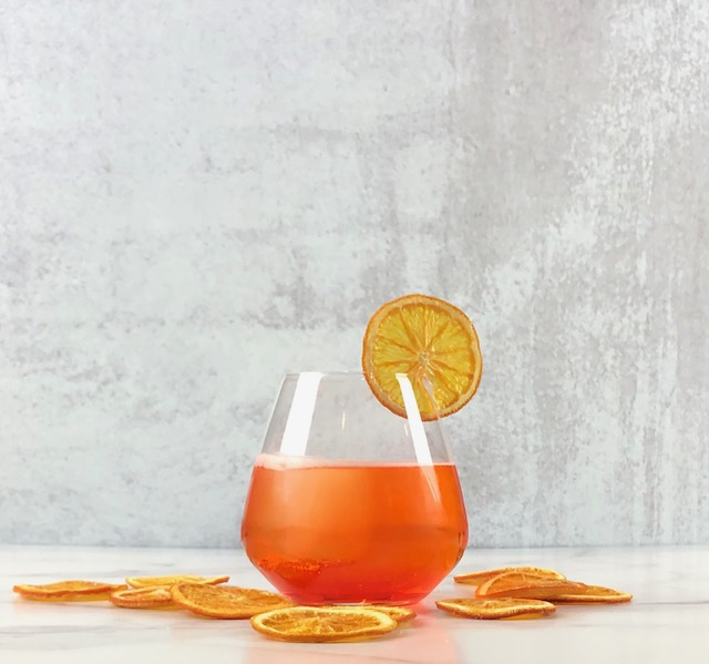 Aperol Spritzes with Preserved Orange Slices